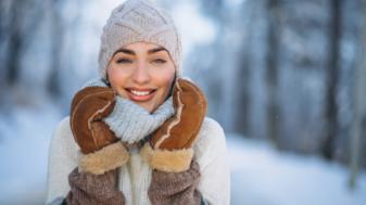 Portrait of happy woman in winter park